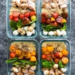 overhead shot of caprese chicken salad meal prep bowls on gray counter