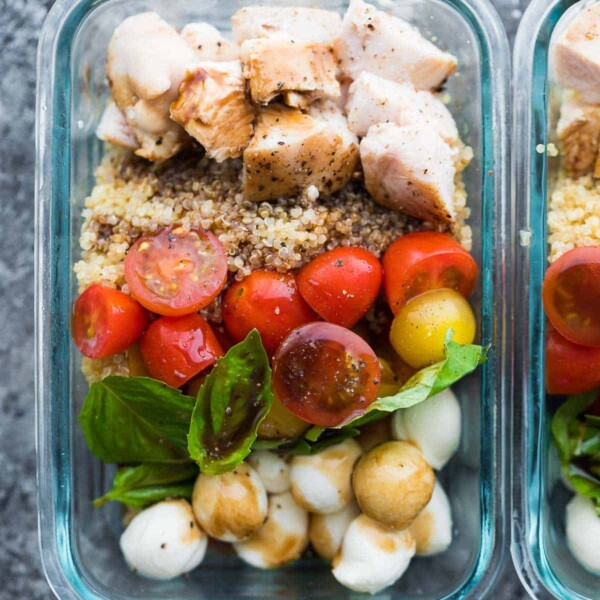 close up shot of caprese chicken salad meal prep bowl in glass container