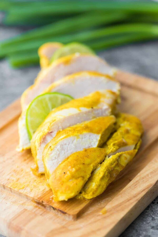 sliced chicken that had been marinated in yogurt curry marinade
