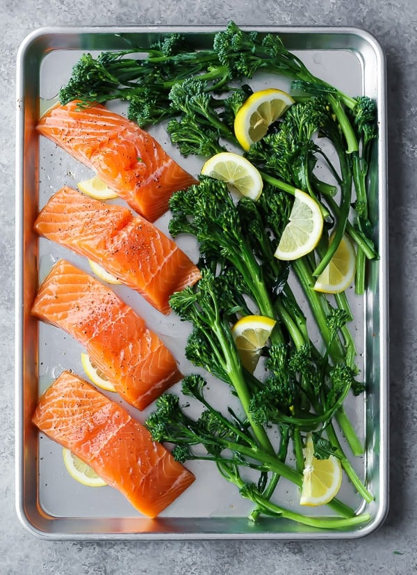 A simple honey lemon salmon recipe baked up on a sheet pan with broccolini. Serve over rice and drizzle with the honey lemon sauce. Makes a great meal prep lunch.