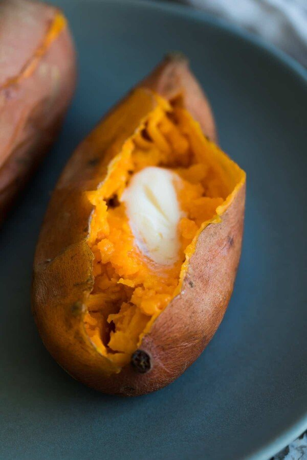 sweet potato on plate with melted butter