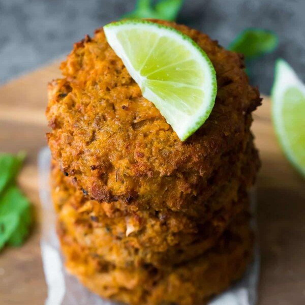 stack of thai salmon patties with lime wedge on top