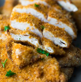 pile or air fryer chicken breasts with one sliced