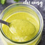Close up shot of creamy cilantro lime dressing in a glass mason jar with a spoon