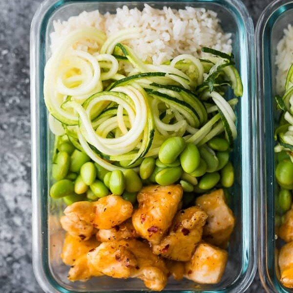 overhead shot of firecracker chicken meal prep bowl in glass container
