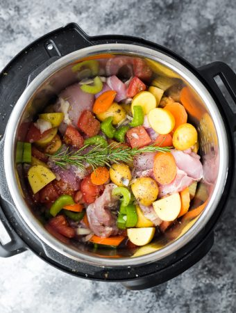 overhead shot of tuscan chicken stew ingredients in the crockpot