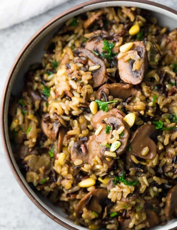closeup shot of wild rice pilaf with mushrooms and pine nuts