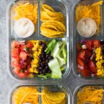 overhead shot of taco salad bento lunch boxes in glass containers