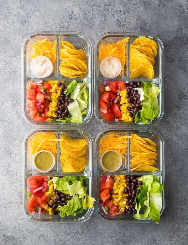 overhead shot of no cook taco salad bento boxes on gray counter