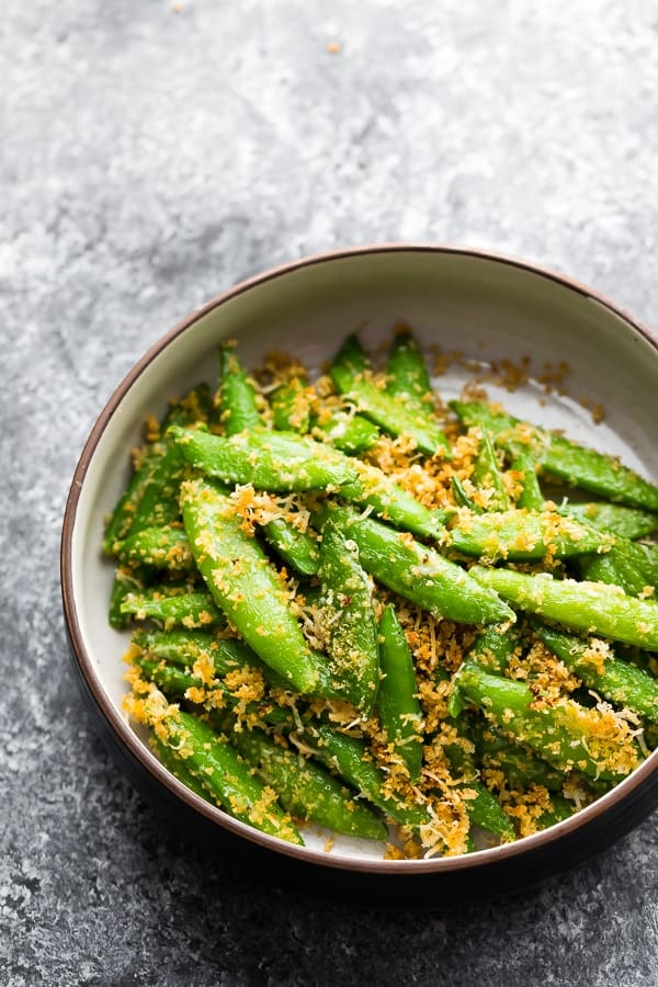 roasted sugar snap pea recipe in a bowl with parmesan and panko