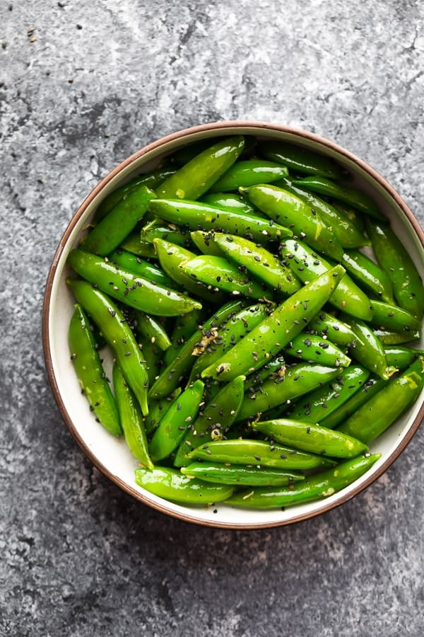 garlic sesame sugar snap peas recipe in a bowl