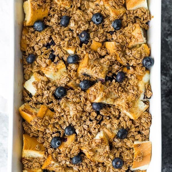 Overhead shot of blueberry overnight french toast bake in white baking dish