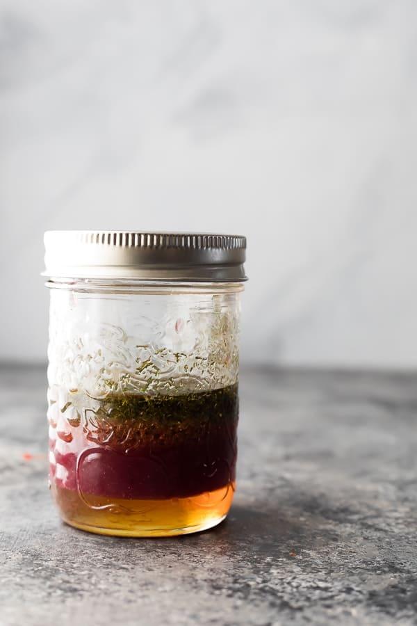 Jar of red wine vinaigrette for easy pasta salad recipe