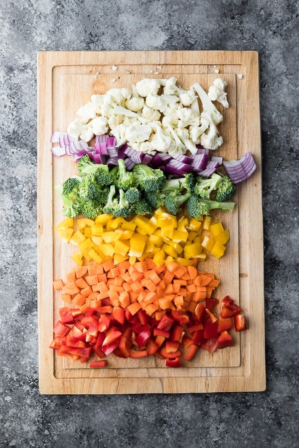 Healthy Greek Pasta Salad Recipe vegetables prepped on cutting board