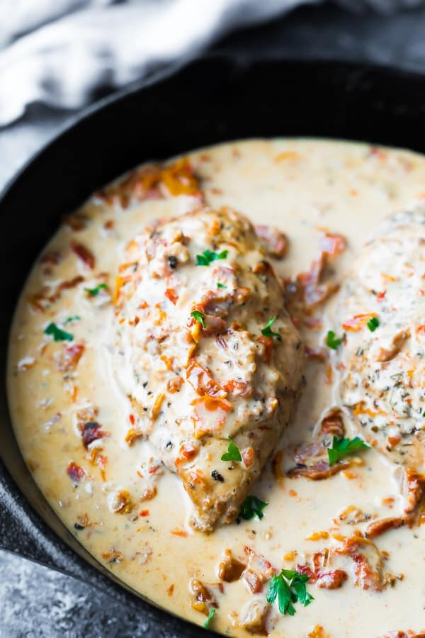 close up of the chicken with sun dried tomato cream sauce in skillet