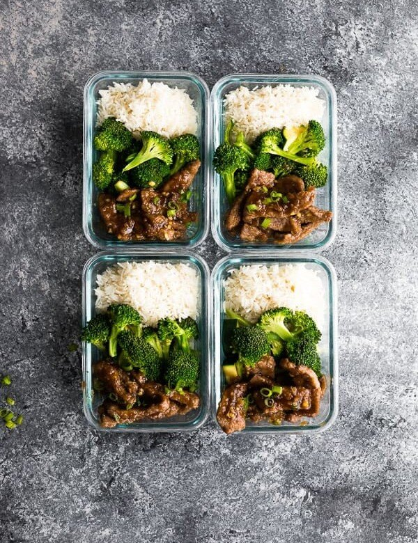 overhead shot of four mongolian beef and broccoli meal prep bowls