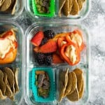overhead shot of vegan bento snack boxes in glass meal prep container