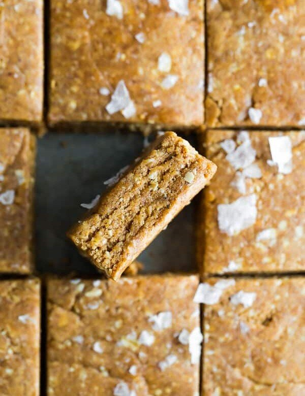 overhead shot of homemade protein bars cut into squares with one on its side