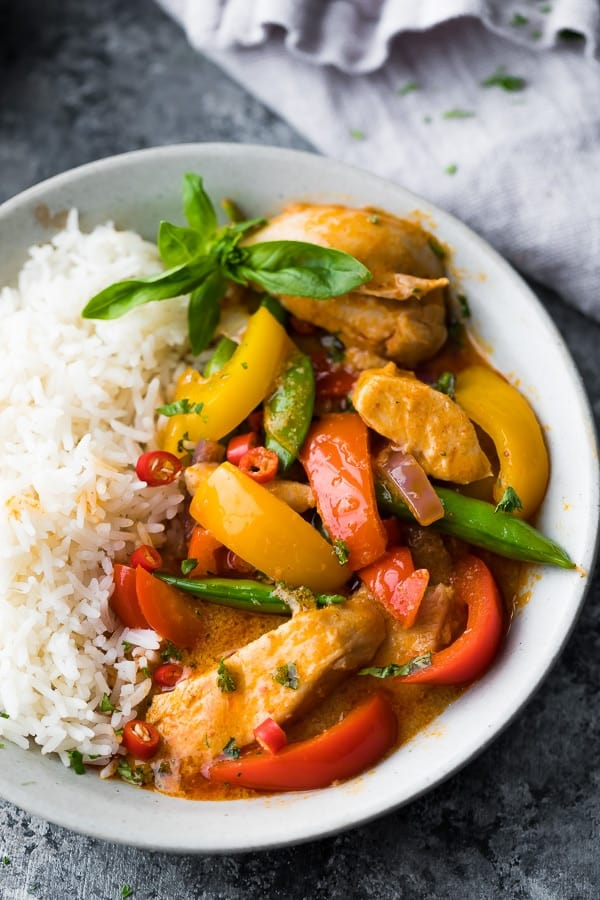 close up of the spicy thai chicken curry recipe in a bowl with rice