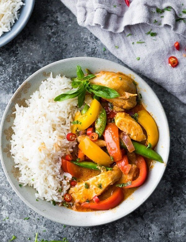 overhead view of Instant Pot Thai Chicken Curry in a bowl with rice