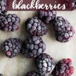 frozen blackberries on wood cutting board
