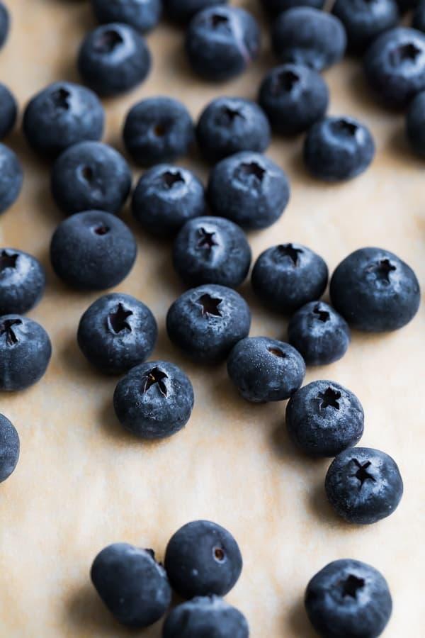 close up shot of blueberries on baking sheet