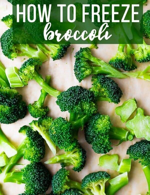 A bunch of broccoli on wood cutting board
