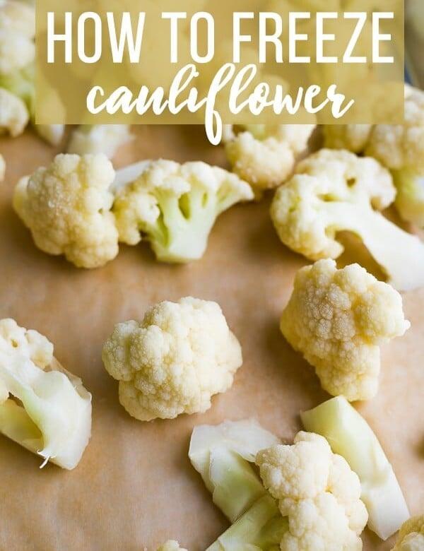 lots of cauliflower sitting on a wood cutting board