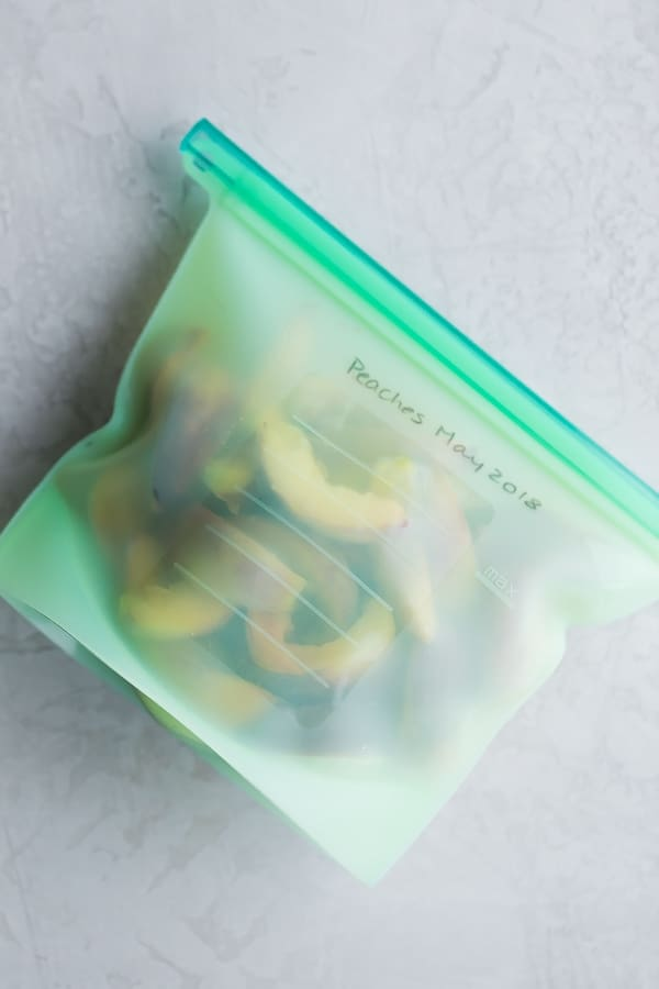 frozen peaches in silicone freezer bag
