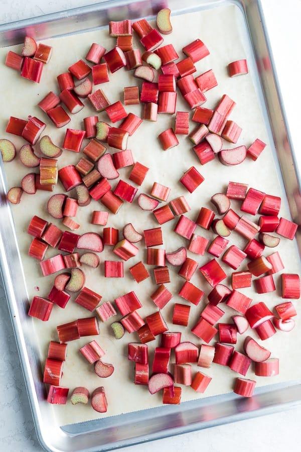 rhubarb chopped and arranged on baking sheet, ready for freezer