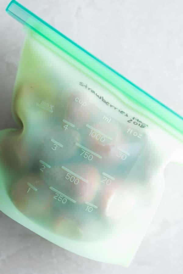 frozen strawberries in silicone freezer bag