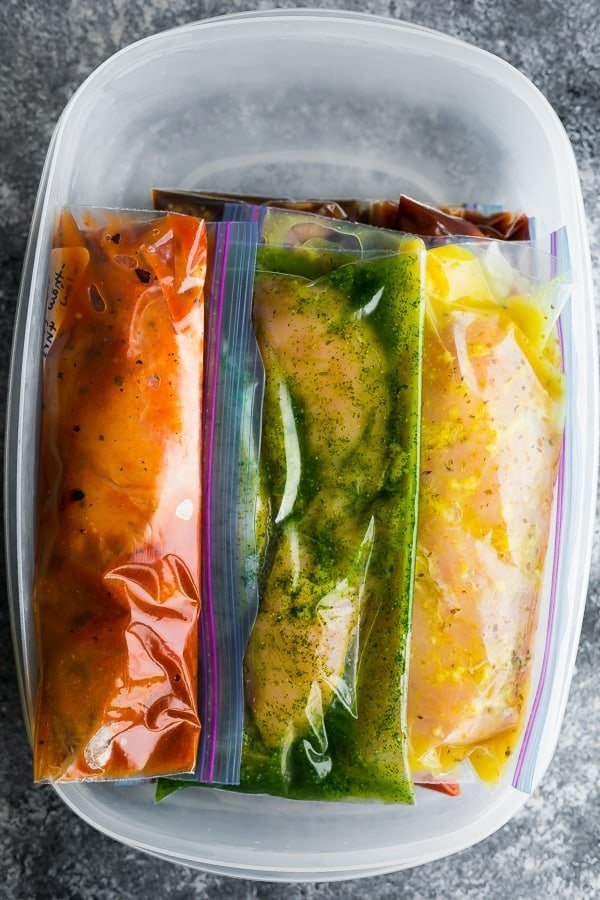 slow cooker chicken recipes in freezer bags in a plastic container