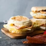 three copycat starbucks egg white breakfast sandwiches on wood board
