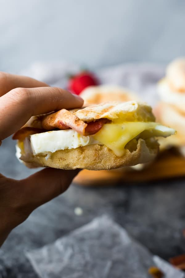 hand holding a copycat starbucks egg white breakfast sandwich with bite taken out of it