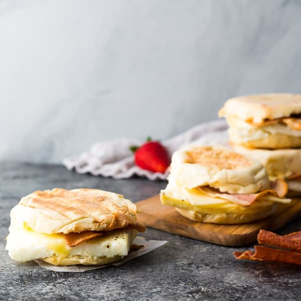 close up Copycat Starbucks Breakfast Sandwich on grey background with other sandwiches in background