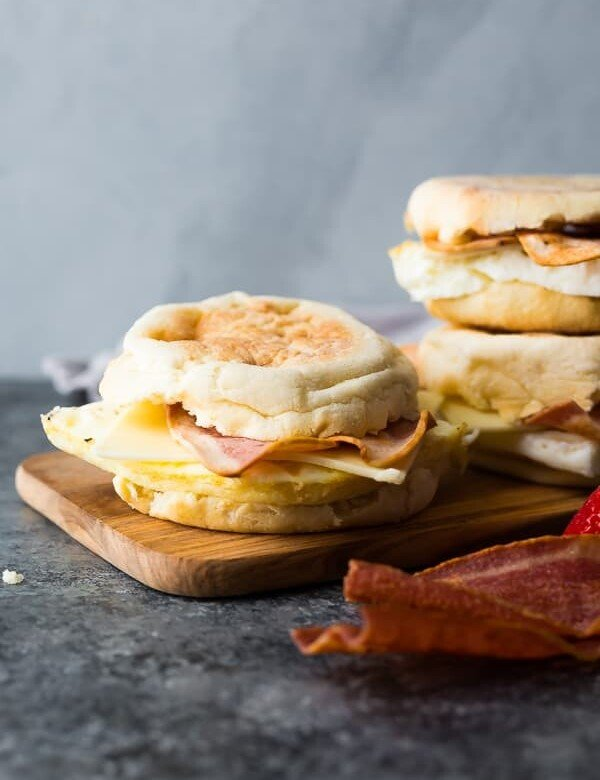 three copycat starbucks egg white breakfast sandwiches on wood board