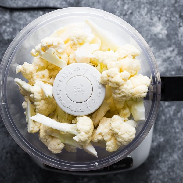 cauliflower in food processor to make cauliflower rice recipes