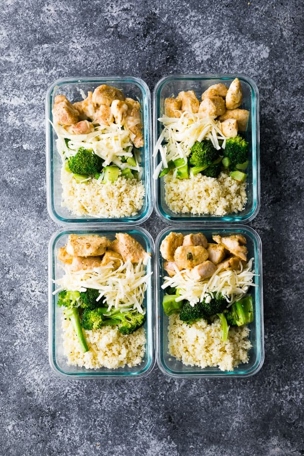 four meal prep containers with the Low Carb Cheesy Chicken and Rice