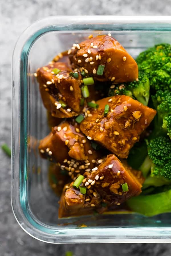 close up of crock pot teriyaki chicken in meal prep container