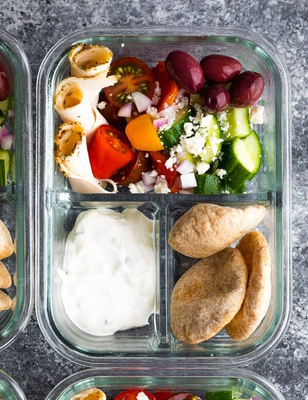 overhead shot of glass meal prep container with no cook greek pita bento and salad
