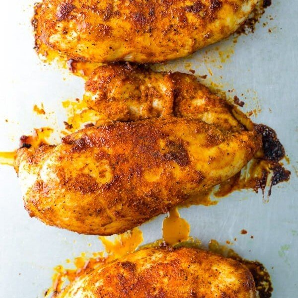 overhead shot of three perfect baked chicken breasts