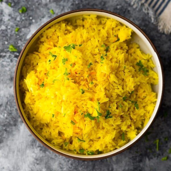 overhead shot of saffron rice in large bowl