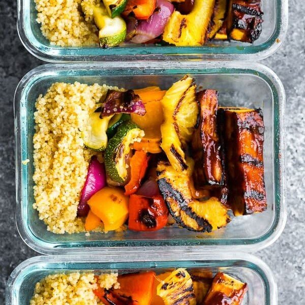 overhead shot of three glass meal prep containers with pineapple bbq tofu