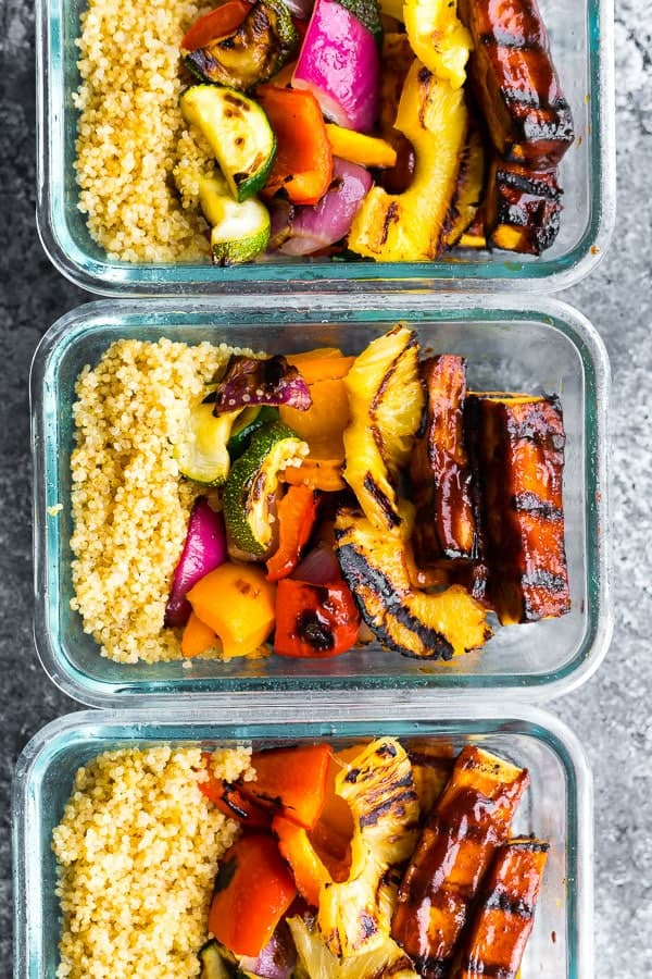 overhead shot of the Pineapple BBQ Tofu Bowls in meal prep containers