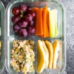 overhead shot of glass meal prep container with chickpea salad bento box