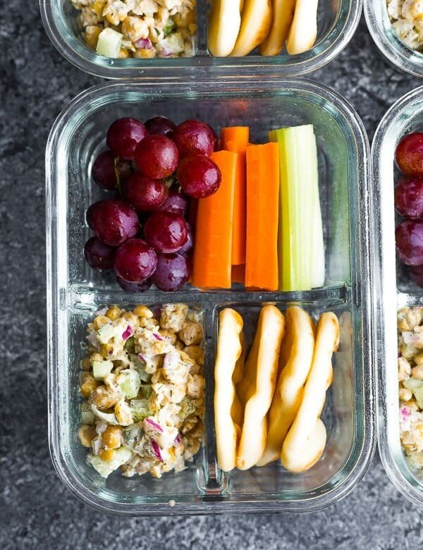 overhead shot of chickpea salad bento box in glass meal prep container