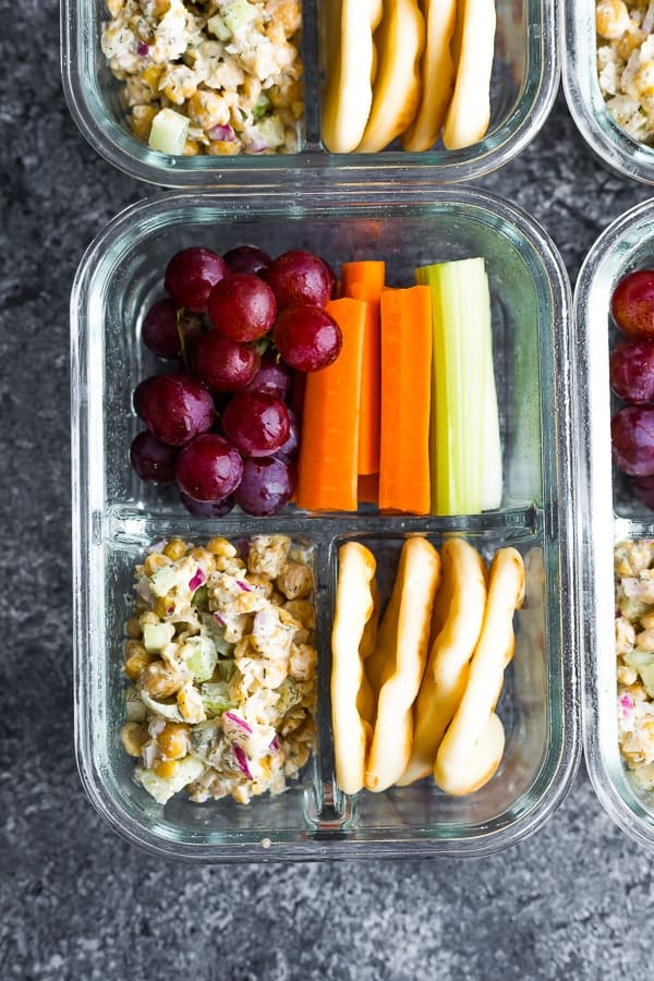overhead view of the Chickpea Salad Bento Box with flatbread, vegetables and grapes