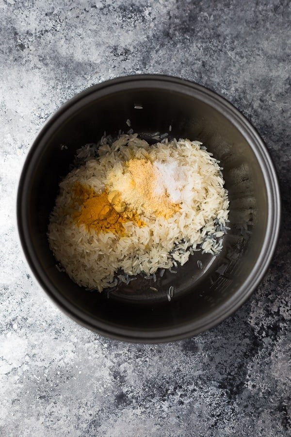 ingredients for yellow rice in a rice cooker