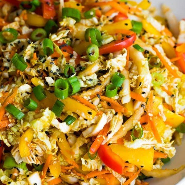 close up shot of sesame asian slaw with chopped green onions