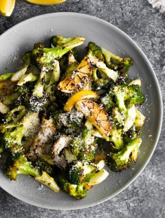 Overhead view of Grilled Broccoli with Lemon and Parmesan in a gray bowl